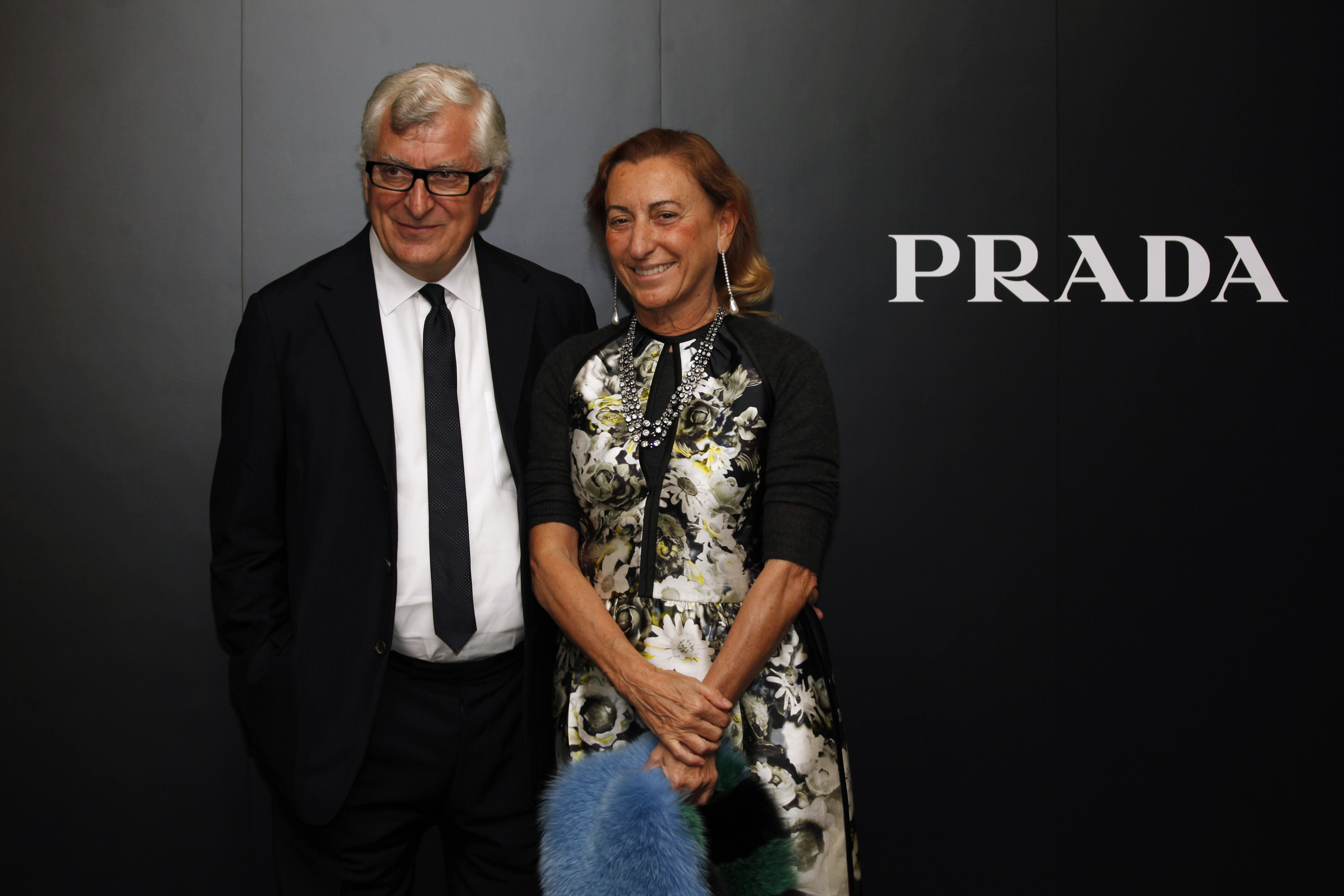 Prada's Chief Executive Patrizio Bertelli poses with his wife, fashion designer Prada, after attending fashion show in Hong Kong